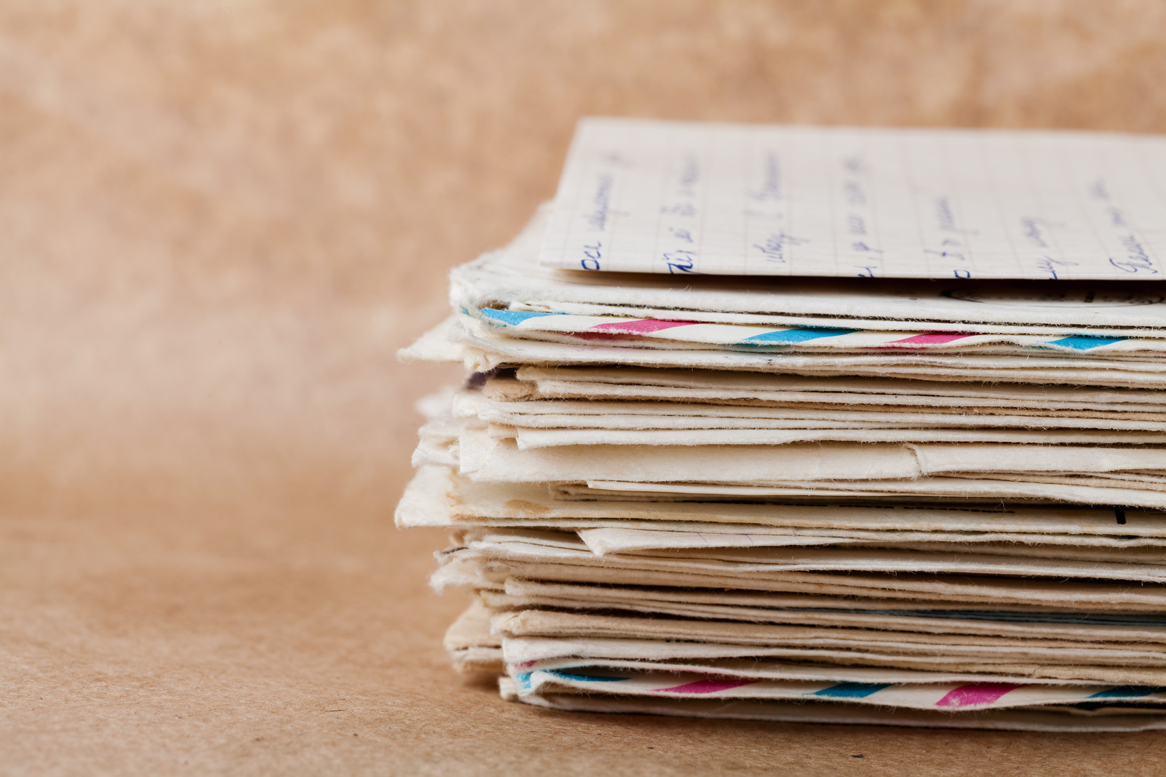 Stack of old envelopes and letters on kraft paper