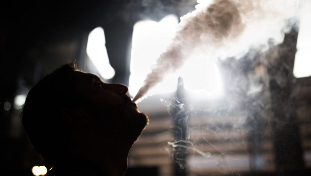 A vaper exhaling vapor in the sky