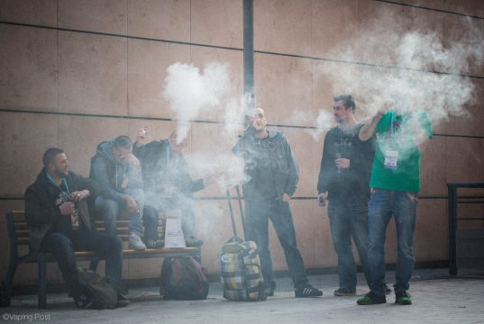 Group of vapers blowing giant clouds