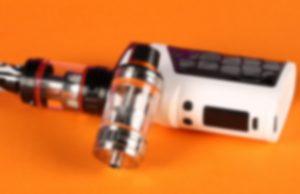 E-cig on orange background