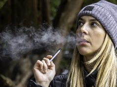 young woman vaping juul