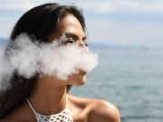 young woman vaping in Hawaii