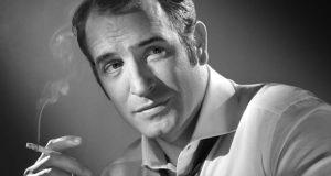 Jean Dujardin smoking a cigarette