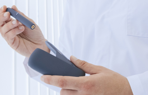 Doctor holding an iQos e-cig