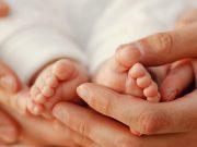 Little baby in his mom's hands