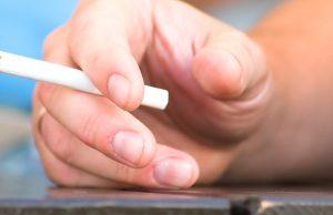 hand of a man smoking a cigarette