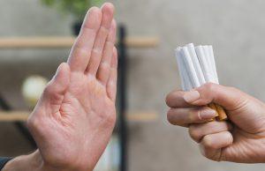 man refusing bunch of cigarettes